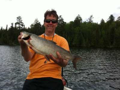 Mark with a whitefish from the Manitou